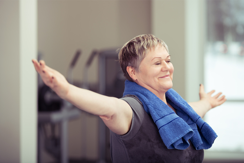 Happy,Senior,Woman,Doing,Aerobics,Exercises,At,The,Gym,Standing